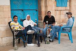 Middle East, Israel, Jerusalem, male teenagers smoking hookah water pipes