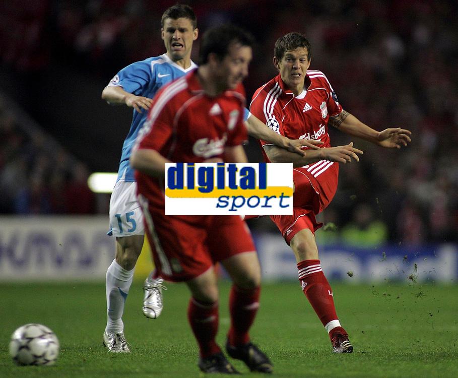 Photo: Paul Thomas.<br /> Liverpool v PSV Eindhoven. UEFA Champions League. Quarter Final, 2nd Leg. 11/04/2007.<br /> <br /> Daniel Agger (R) of Liverpool shoots.