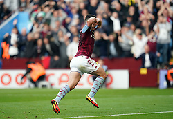 Aston Villa's John McGinn celebrates scoring his sides second goal during the Premier League match at Villa Park, Birmingham. Picture date: Saturday October 16, 2021.