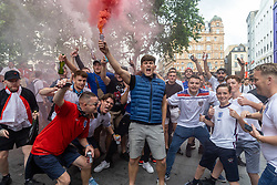 Licensed to London News Pictures. 11/07/2021. London, UK. Fans light flares in Leicester Square in London ahead of England's Euro 2020 finals match. England take on Italy in the Euro 2020 final at the iconic Wembley Stadium this evening. Photo credit: Alex Lentati/LNP