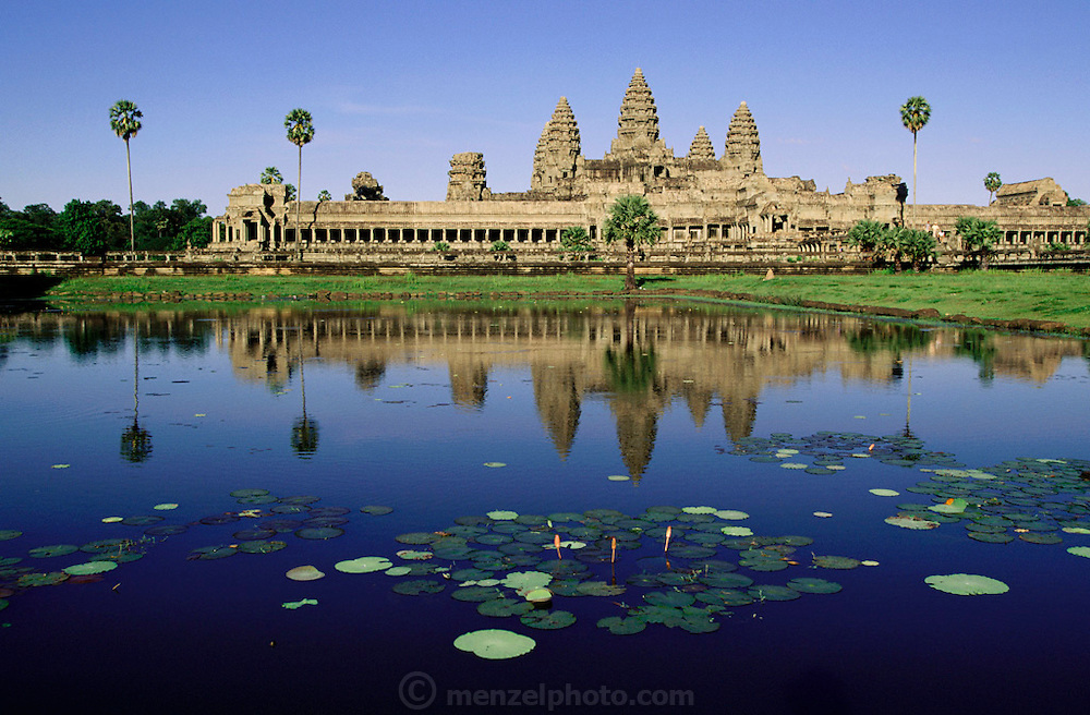 Angkor Wat temple, Cambodia. The temples at Angkor are spread out over some 40 miles around the village of Siem Reap, about 192 miles from the Cambodian capital, Phnom Penh. They were built between the eighth and 13th centuries and range from single towers made of bricks to vast stone temple complexes. Regarded as the supreme masterpiece of Khmer architecture, it is a huge pyramid temple built by Suryavarman II between 1113 and 1150. It is surrounded by a moat 570 feet wide and about four miles long. The bas-relief carvings are of the highest quality and the most beautifully executed in Angkor..