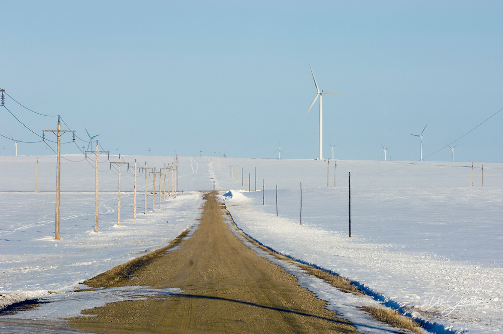 Wind Turbines on snowy prairie, with service road, Somerset, Manitoba, Canada