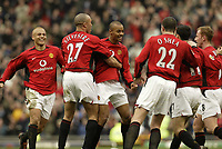Photo. Aidan Ellis.<br />Manchester United v Tottenham Hotspur.<br />FA Barclaycard Premiership.<br />20/03/2004.<br />United celebrate the third goal scored by David Bellion
