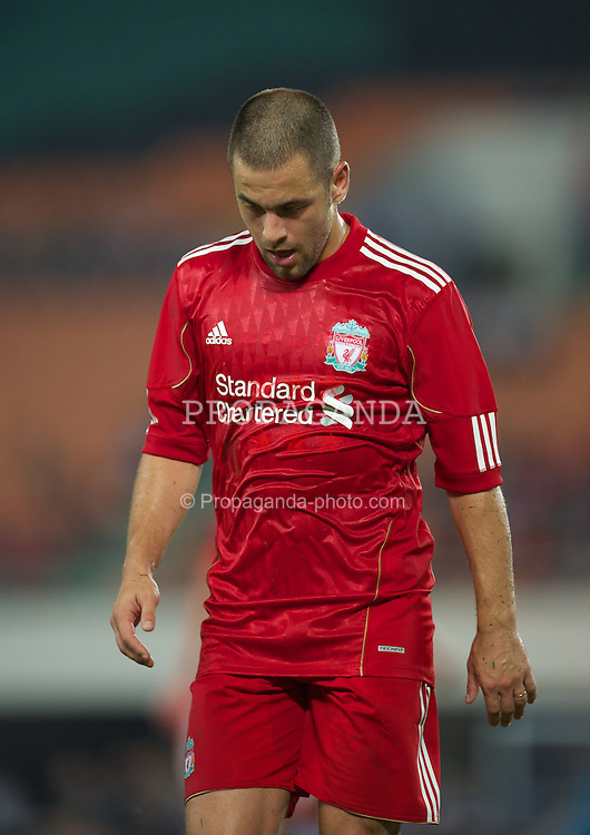 GUANGZHOU, CHINA - Wednesday, July 13, 2011: Liverpool's Joe Cole in action against Guangdong Sunray Cave during the first pre-season friendly on day three of the club's Asia Tour at the Tianhe Stadium. (Photo by David Rawcliffe/Propaganda)