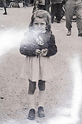 little girl portrait France ca 1940s photo with surface light reflection