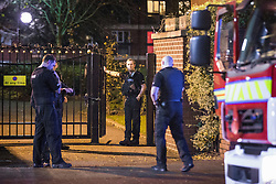 © Licensed to London News Pictures . 05/11/2015 . Salford , UK . Fire crews and police attend at a block of flats off the A57 in Weaste . Manchester Fire reports receiving more than 300 calls in less than 7 hours, from 4.30pm, including to buildings, cars and wheelie bins set alight by arsonists . At some calls fire crews were subject to vandalism , including a hose being sliced whilst it was being used to fight a fire in Leigh and bricks being thrown at crews attending a job in Miles Platting . Fire crews deal with arson attacks across Greater Manchester during Bonfire Night . Photo credit : Joel Goodman/LNP