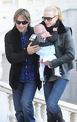 Nicole Kidman, Keith Urban with their daughter Sunday Rose leaving the Ritz hotel in Paris, France on December 2, 2008. Kidman is in Paris to promote her new movie 'Australia'. Photo by ABACAPRESS.COM    171742_012