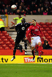 Bristol City's Damion Stewart Battles for the ball with Nottingham Forest's David McGoldrick - Photo mandatory by-line: Matt Bunn/JMP - 25/01/2011 - SPORT - FOOTBALL - npower championship-Nottingham Forest v Bristol city-City Ground-Nottingham