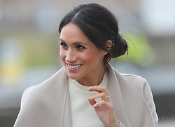 Meghan Markle arrives with Prince Harry for a visit to the Titanic Belfast maritime museum in Belfast.