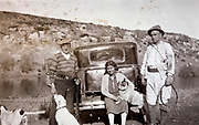 hunters with dogs and woman standing by their automobile 1930s