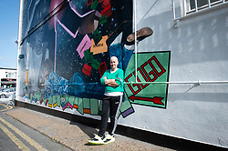 A 9 metre George Michael mural painted in Kingsbury by artist Dawn Mellor, North West London, Great Britain <br /> Unveiled 17th September 2020    <br /> <br /> Artist Dawn Mellor with at her large-scale mural that celebrates the life of local hero George Michael who was a 1st year pupil at Kingsbury High School in 1974. <br /> Commissioned as part of the Brent supported by the Brent Borough of Culture 2020 fund. <br /> <br /> Photograph by Elliott Franks
