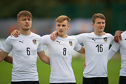 NEWPORT, WALES - Monday, October 14, 2019: Austria's (L-R) Robert Martic, Niels Hahn and Fabian Tauchhammer line-up before an Under-19's International Friendly match between Wales and Austria at Dragon Park. (Pic by David Rawcliffe/Propaganda)