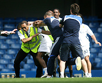 LONDON, ENGLAND - Saturday, April 26th, 2008:  Manchester United's Patrice Evra (white shorts, obscures) fights a groundsman (second from right) as the players warm down after the game against Chelsea during the Barclays Premiership match at Stamford Bridge. (Photo by Chris Ratcliffe/Propaganda)
