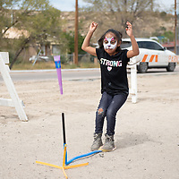 Soraya Padderson, 6, launches her paper rocket during the Northfest in Gallup Saturday afternoon.