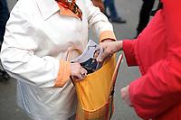 DEU, Deutschland, Germany, Magdeburg, 17.09.2013:<br />Bei einer Wahlkampfveranstaltung der CDU auf dem Alten Markt stecken sich Rentnerinnen eine Broschüre der Bundeskanzlerin Dr. Angela Merkel in die Handtasche.