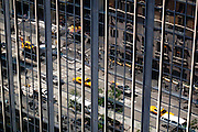 New York, New York. United States. May 7th 2010..Reflection of 6th Avenue (Avenue of The Americas) between 54th and 55th Street.