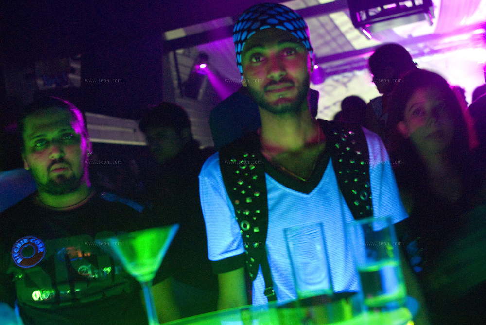 Karan (21, right) and a friend on Saturday night at Elevate night club in Noida. Elevate, located at Center Stage mall in Noida, is the leading nightclub in the Delhi area.