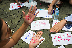 © Licensed to London News Pictures. 27/05/2014. An Anti-Coup protestor holds up both of her hands which read 'No Coup' during a Anti-Coup protest in Bangkok Thailand. yesterday Thailand's King formally approved Thai army chief General Prayut Chan-O-Cha as head of the nation's new military junta.  Photo credit : Asanka Brendon Ratnayake/LNP
