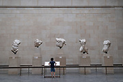 Now re-opened after months of closure during the Coronavirus pandemic, one of the first young visitors who have pre-booked free tickets, once again enjoy the Elgin Marbles and other historical artifacts in the British Museum, on 2nd September 2020, in London, England.