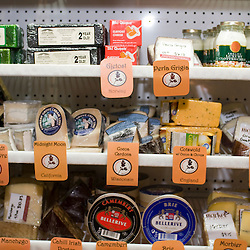 Frederick, Maryland - Inside the Firestone Market on N. Market Street in downtown Frederick, a variety of artisanal cheeses are on display.  Photo by Susana Raab
