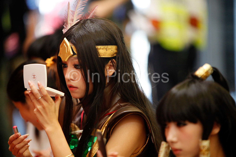 Cosplay performers apply make up and wait for their turn at the ChinaJoy Expo, also know as the China Digital Entertainment Expo and Conference,  in Shanghai, China on 29 July, 2011. Online and social network games have become hugely popular in China as Chinese children lack the space and facility require for sports, spurning worries from parents and government officials on internet addiction.