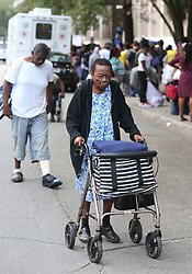 Sadie Jones, 81, arrives using her walker from her home to join hundreds of local residents being evacuated from the city at the Savannah Civic Center during a mandatory evacuation for Hurricane Irma on Saturday, September 9, 2017, in Savannah, Ga. Officials are expecting 1,500 to 3,000 without transportation to leave by buses that are being provided. Photo by Curtis Compton/Atlanta Journal-Constitution/TNS/ABACAPRESS.COM
