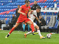 Football - 2020 / 2021 UEFA Nations League - Group B4 - Wales vs Bulgaria<br />      <br /> Ivan Goranov of Bulgaria tackled by Gareth Bale of Wales<br /> in a match played with no crowd due to Covid 19 coronavirus emergency regulations, in an almost empty ground, at the Cardiff City Stadium.<br /> <br /> COLORSPORT/WINSTON BYNORTH