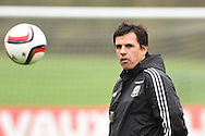 Wales football team manager Chris Coleman has his eye on the ball during the Wales football team training at Hensol Castle, Vale of Glamorgan, South Wales on Tuesday 10th November 2015. the team are training ahead of their friendly against the Netherlands on Friday,<br /> pic by  Andrew Orchard, Andrew Orchard sports photography.