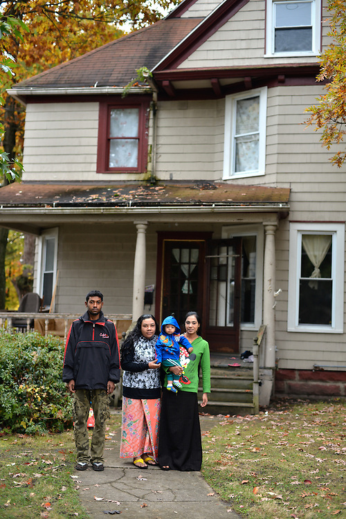 Family standing outside of their home in North Hill.