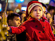 22 DECEMBER 2017 - HANOI, VIETNAM: A child in a Santa Claus hat watches the Christmas show at St. Joseph's Cathedral in Hanoi. There are about 5.6 million Catholics in Vietnam. The Cathedral was one of the first structures built by the French during the colonial era and was opened in 1886. It's one of the most popular tourist attractions in Hanoi.    PHOTO BY JACK KURTZ