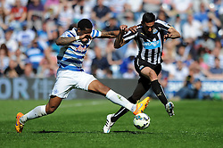Queens Park Rangers' Leroy Fer challenges Newcastle United's Jonas Gutierrez - Photo mandatory by-line: Dougie Allward/JMP - Mobile: 07966 386802 - 16/05/2015 - SPORT - football - London - Loftus Road - QPR v Newcastle United - Barclays Premier League