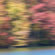 Shoreline of Clear Fork Reservoir in autumn, captured with in-camera impressionistic blur.