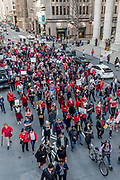 """Demonstraters march through San Francisco toward ICE headquarters after a rally on International Women's Day. Many demonstrators wore red to show support for the """"Day without a Woman"""" strike."""
