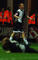 Photo: Paul Greenwood.<br />Preston North End v Luton Town. Coca Cola Championship. 04/11/2006. Preston player Brett Oremerod smiles in celebration as Luton keeper Dean Brilli lies prostate on the ground.