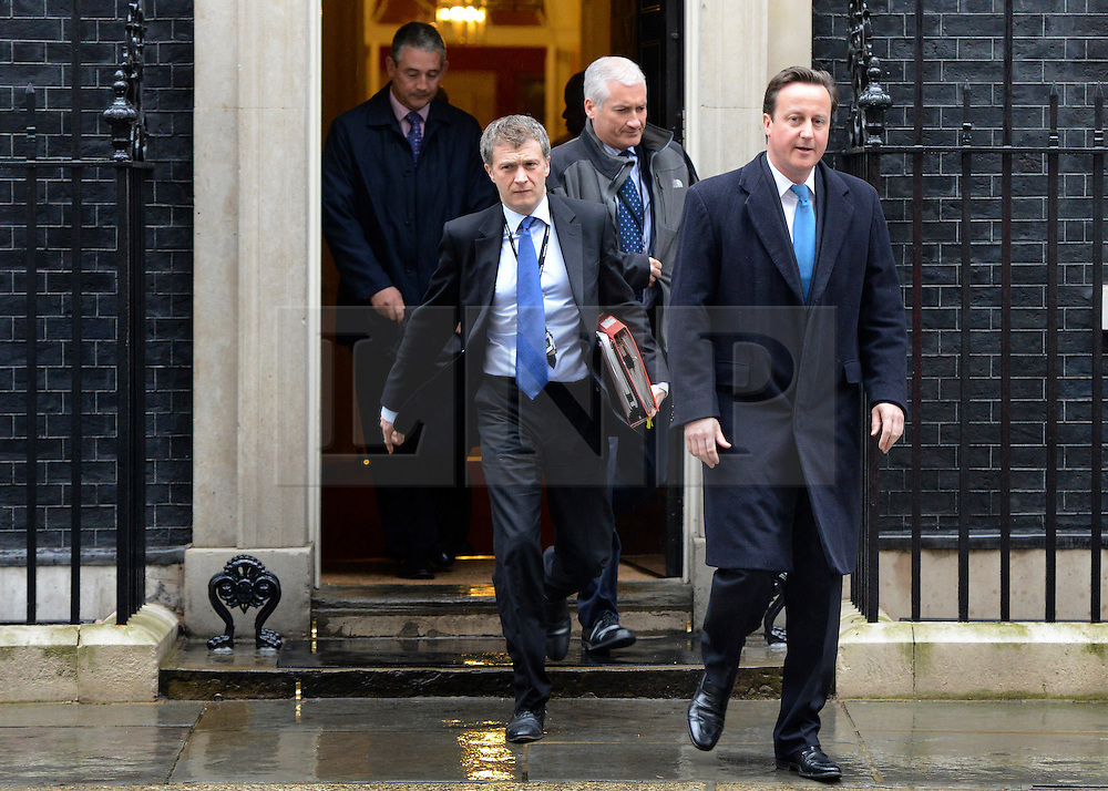 © Licensed to London News Pictures. 25/04/2012. Westminster, UK . The Prime Minister David Cameron leaves Downing Street today 25 April 2012 for Prime Ministers Questions at the Houses of Parliament. Photo credit : Stephen Simpson/LNP