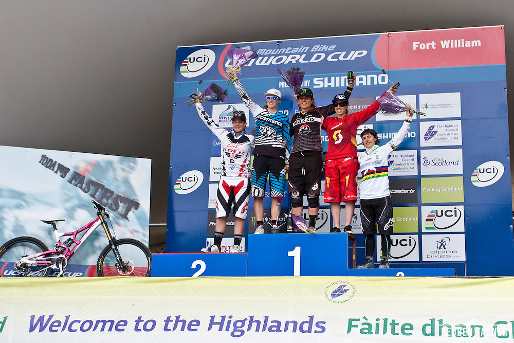 Maxxis Rocky Mountain's Sabrina Jonnier takes the top spot on the podium, with Rachel Atherton taking second. Floriane Pugin in 3rd, Tracy Moseley 4th and Emmeline Ragot in 5th, in the Women's Downhill. UCI Mountain Bike World Cup, Fort William, Scotland.