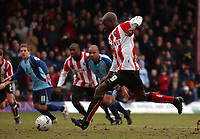 Photo: Olly Greenwood.<br />Brentford v Barnsley. Coca Cola League 1. 11/03/2006. Brentford's Llyod Owusu scores from the penalty spot.