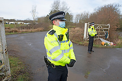 © Licensed to London News Pictures 12/03/2021. Ashford, UK. Police standing guard at the main gate entrance. Teams of Metropolitan police officers continue to search Great Chart Leisure in Ashford, Kent today in connection with the ongoing investigation into the disappearance of Sarah Everard from London. Photo credit:Grant Falvey/LNP