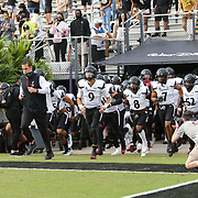 ORLANDO, FL - NOVEMBER 21:  The Cincinnati Bearcats enter the field against the Central Florida Knights at Bounce House-FBC Mortgage Field on November 21, 2020 in Orlando, Florida. (Photo by Alex Menendez/Getty Images) *** Local Caption ***