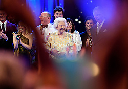 Queen Elizabeth II with performers on stage at the Royal Albert Hall in London during a star-studded concert to celebrate the Queen's 92nd birthday.