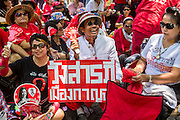 08 MAY 2013 - BANGKOK, THAILAND:  Thai Red Shirts rally in front of the parliament building in Bangkok. A splinter group of the Red Shirts, Thai supporters of exiled Prime Minister Thaksin Shinawatra, have besieged the Thai Constitutional Court for the last three weeks calling for the resignation of the justices, who have indicated they might oppose a proposed constitutional reform which would grant amnesty to people convicted of political crimes since 2007. This would probably include Thaksin. The justices have refused to step down. Wednesday the protesters moved their protest to the Thai Parliament, which is largely powerless to intervene.  PHOTO BY JACK KURTZ