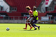 Bristol City's Han-Noah Massengo (42) under pressure from Exeter City's Nigel Atangana (4) during the EFL Cup match between Bristol City and Exeter City at Ashton Gate, Bristol, England on 5 September 2020.