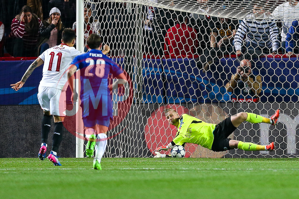 Kasper Schmeichel of Leicester City saves a penalty from Joaquin Correa of Sevilla - Rogan Thomson/JMP - 22/02/2017 - FOOTBALL - Estadio Ramon Sanchez Pizjuan - Seville, Spain - Sevilla FC v Leicester City - UEFA Champions League Round of 16, 1st Leg.