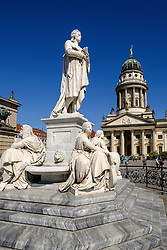 Statue of Schiller in Gendarmenmarkt square with Franzosischer Dom to rear in Mitte Berlin Germany