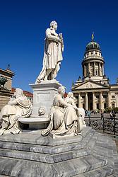 Statue of Schiller in Gendarmenmarkt square with Franzosischer Dom to rear in Mitte Berlin Germany