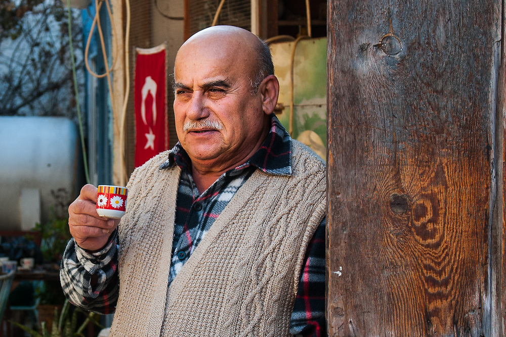 An old turkish cypriot man drinks a coffe in his house near the border of the wall that divide the city of Nicosia, Cyprus.<br /> Nicosia was divided into the southern Greek Cypriot and the northern Turkish Cypriot parts in 1963, following the intercommunal violence that broke out in the city. Today, the northern part of the city is the capital of Northern Cyprus, a de facto state that is considered to be occupied Cypriot territory by the international community. ©Simone Padovani / Awakening