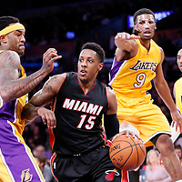 13 January 2014: Miami Heat guard Mario Chalmers (15) drives past Los Angeles Lakers guard Ronnie Price (9) and Los Angeles Lakers center Jordan Hill (27) during the Miami Heat 78-75 victory over the Los Angeles Lakers, at the Staples Center, Los Angeles, California, USA.