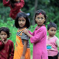 Asia, Nepal, Kathmandu, Kirtipur. Children of Kirtipur wait for turn on swing.