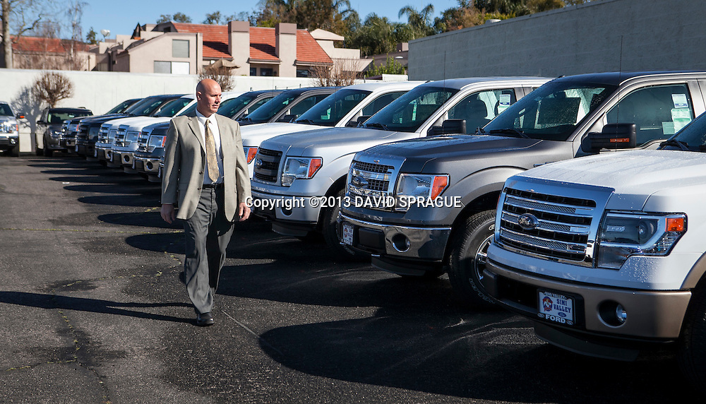 Mike Shell, Fleet Manager at Simi Valley Ford walks by some Ford trucks at the dealership. The dealership is running a campaign through Earth Day on April 22 in which the company will make a two-year carbon offset donation to carbonfund.org for every car purchased. Shot Feb. 19th,  2013 Photo by David Sprague ©2013