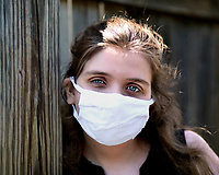 high school girl in mask didnt get to have a prom or graduation because of virus outbreak, Columbia,  south carolina photo by Catherine Brown